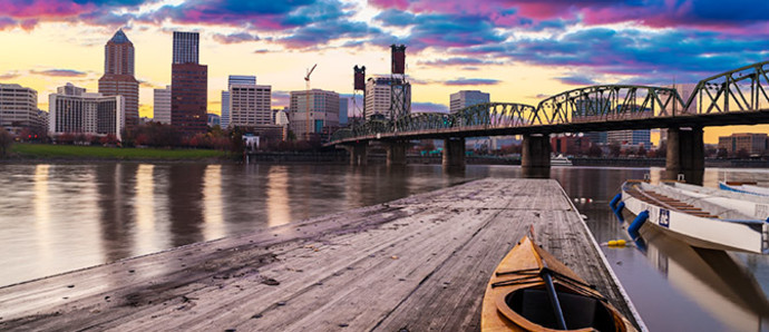 view of portland from river with canoe in foreground