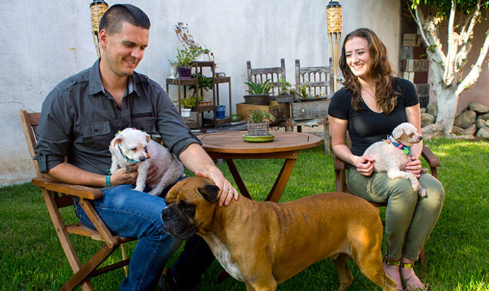 morgan and jon with their three dogs