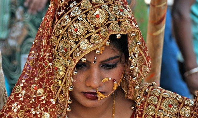 image of a bridge on her wedding day by the Ganges in Varanasi,  India
