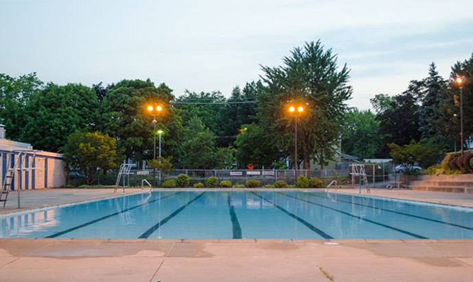 outdoor swimming pool at dusk in Toronto, free of any swimmers
