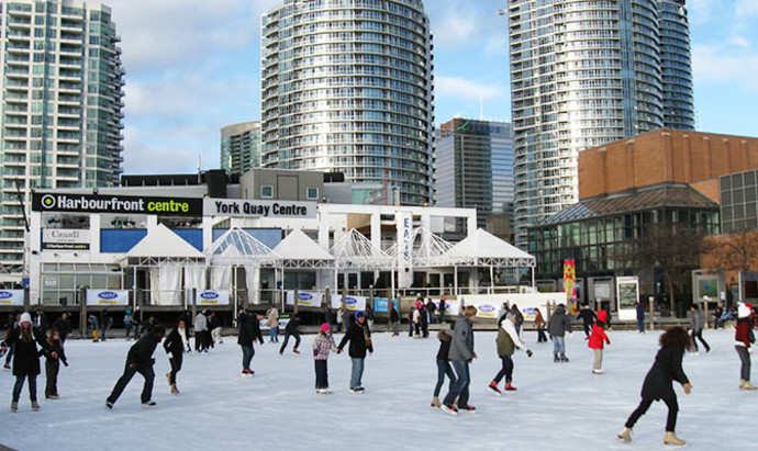 People ice-skating at the Harbourfront Centre in Downtown Toronto