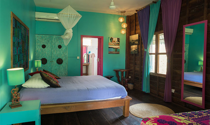 Valentina's brightly coloured guest bedroom in her homestay in Siem Reap