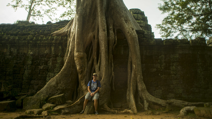 Bryan and a big tree in Cambodia