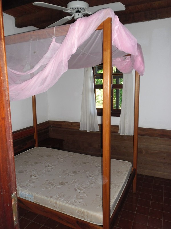 Four poster with mosquito net
