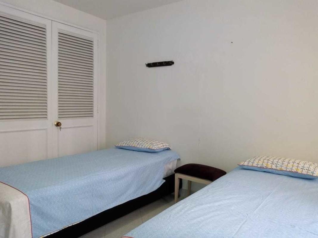 Twin room 2 single beds with shared bathroom